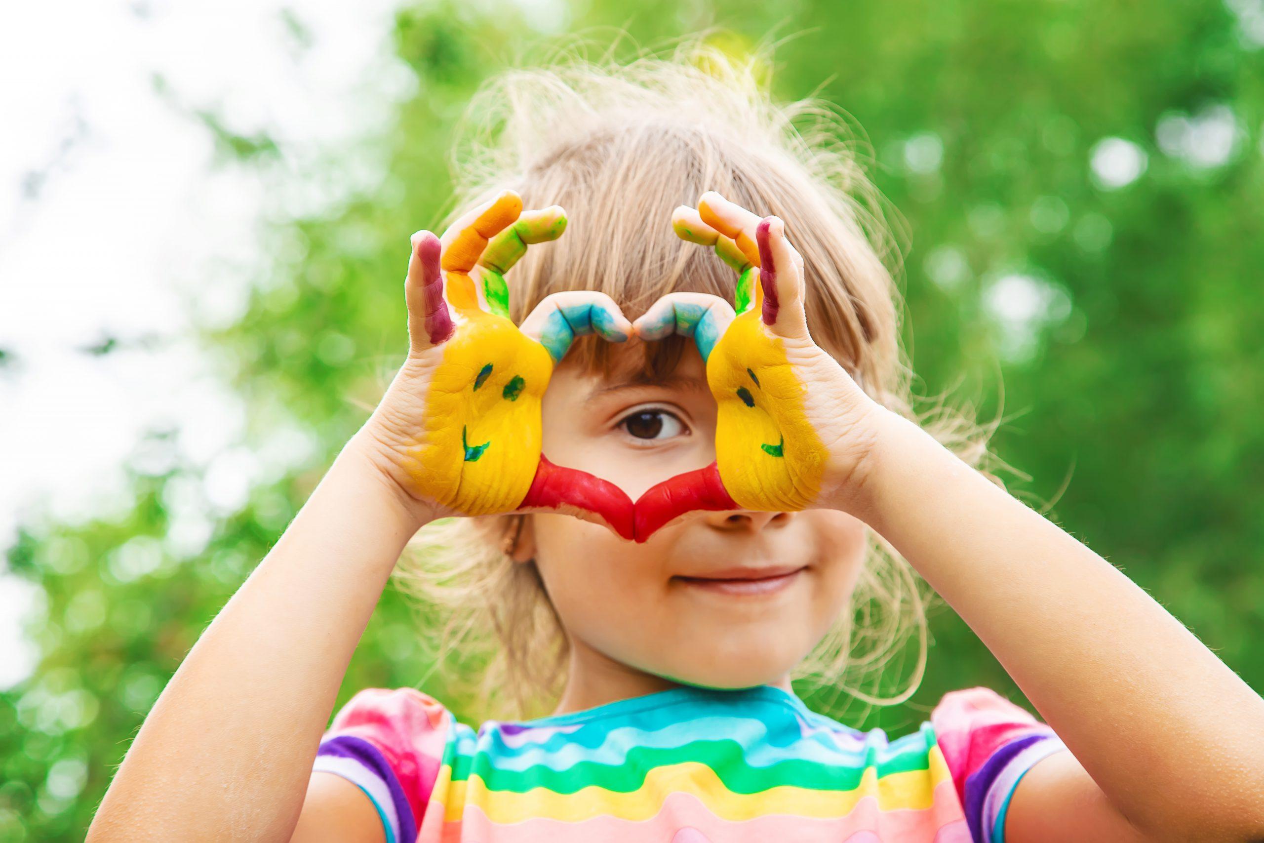 children hands in colors. Summer photo. Selective focus. nature